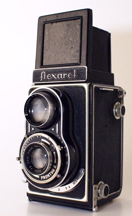My history of Czech TLRs part 5: The Optikotechna Flexaret II. The first real post-WWII camera of the Flexaret family. Produced by Optikotechna before it was swallowed into the state run Meopta concern. This shows many of the marks of all following flexarets most notably the front standard focussing (at last - no more strings) with the focus knob/anchor and distance scale in an arc below the taking lens. The taking lens is a bit cheap and nasty: a Mirar 8cm/4.5 triplet. The focusing screen is still dull (doesn't really get much better in later Flexarets either) but the focus is smooth, the red window works and the Prontor II shutter is about as good as one could expect from an inexpensive camera in the aftermath of the war. This example is actually rather nice to use: shutter, aperture and focus are all good. She doesn't get taken out often enough though, the younger and more robust models get a bit more attention. Not as rare as the Flexaret I (or the III for that matter) but not the ubiquitous floozy that is the IIa either. More about her later.