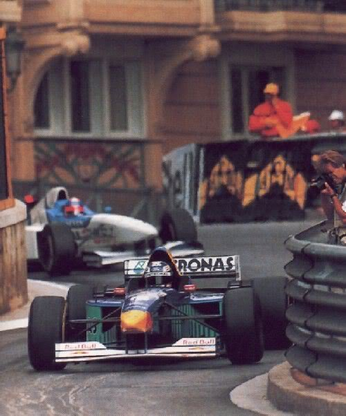hakkalocken:  Heinz-Harald Frenzen (Sauber) leads Ukyo Katayama (Tyrrell) during the 1996 Monaco Grand Prix.  The 1996 Monaco Grand Prix was a funny race. Pole sitter Michael Schumacher who had dominated a year earlier and would go on to dominate a year later in similar wet conditions, crashed out on the first lap. Damon Hill, set to win at the track that made his father most famous, suffered an engine blow-up while a good 30 seconds ahead of the pack. Then Jean Alesi stepped up, a noted rain master with the fast Benetton-Renault car, but he too suffered to mechanical failure. French driver Olivier Panis would go on secure Ligier's final ever win in their final ever season, with David Coulthard finishing a close second.
