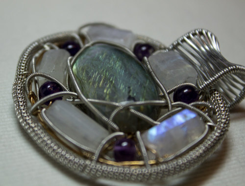 Wire wrapped Labradorite by Michael Form the Lost Boys Rags.  accented by a ring of Moonstones and Syberian Amethysts.