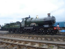 Image: GWR City Class No. 3717 City of Truro just outside Toddington Station, being cleaned.  Steamy Talks No.21: City of Truro is not amused… City of Truro: Oi you…! Mind the paintwork! I've only just got it…