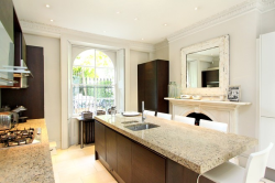 London Family Home  02/27/12 Price: $6,300,000 Location: London, United Kingdom This fully refurbished six-bedroom house with a self-contained secondary suite overlooks Kensington Gardens.— Nick Clayton The 3,100-square-feet property is arranged across four floors. The kitchen-dining room and conservatory are on the raised ground floor. The main reception room is on the first floor. There are gardens to the front and rear. Photo: Douglas & Gordon