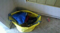 "3/3/12 - An Ikea shopping tote filled with womens shoes, and a case for a ""Simply Red Greatest Hits"" cassette."