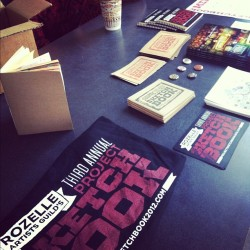 #projectsketchbook2012 merch! Shirts, buttons, catalogs, prints, etc. COME ON DOWN! (Taken with Instagram at The Power House)