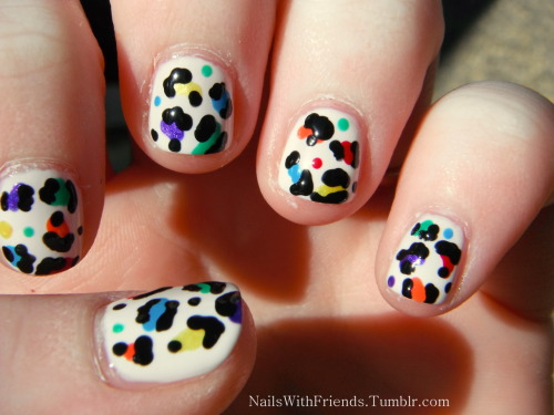 RAINBOW ANIMAL PRINT!  I started out with a base coat of Essie: Marshmallow and then did the colors: Sinful Colors: -Lang Lang -Aquamarine  -Rise and Sunshine -Big Daddy -Black on Black ORLY: Hook Up China Glaze: Winter Berry   And all this was topped off with e.l.f. matte finisher  Hannah!