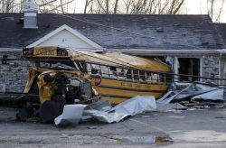reuters:  A school bus came to rest into a structure after being tossed by a tornado that moved through the area in Henryville, Indiana March 3, 2012. A series of tornadoes tore through the U.S. midsection on Friday, killing at least 10 people in the hard-hit state of Indiana, and blowing apart homes and flattening buildings across the region. [REUTERS/John Sommers II] Read more: Rescues, cleanup continue in vast tornado zones