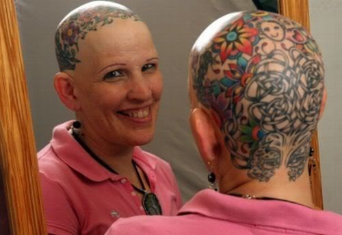 fuckyeahtattoos:  Dotty Jenkins, 48, Effingham, NH   Tattoos done at White Mountain Tattoo in North Conway, NH by Adam Mazza I lost my hair due to an autoimmune disease called Alopecia Areata so I decided that people are going to stare at a bald woman so I would give them something awesome to stare at and when asked about it I can spread awareness of this life changing disease.