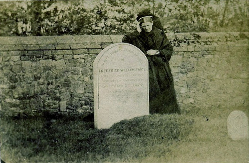 "Mourner at the Grave, Albumen Carte de Visite, Circa 1863 by lisby1 on Flickr.  ""Copied by the London Photographic Compy., 1B Norfolk Terrace, Bayswater W., and 304 Regent Street W."" This is a mass-produced sentimental image. The woman, dressed in widow's mourning, laments at a real grave—however, it is too old a grave to be any of any freshly lost relative of her own. Thanks to modern technology the inscription can be read as ""In affectionate remembrance of Frederick William Paige…who departed this life September 11, 1814, age 35."""