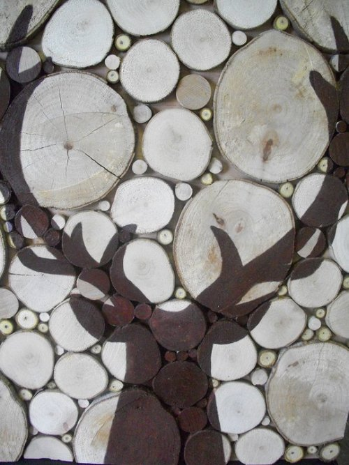 "The deer silohuette is painted onto various sizes of wood slices to create a woodland art piece.  Size: 24""w x 28""h Wholesale price: $40 Retail price: $75"