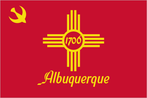 Albuquerque (1969-Present) Is it just me or does this flag look crazy communist? Like, I get that it's a dove symbol and not a hammer and sickle but the resemblance is uncanny. It makes me wonder how this flag could have possibly been adopted in the middle of the cold war. Looks pretty cool in any case. They lose points for putting the city name right there on the flag but gain a few back for using an excellent font.