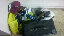 3/3/12 - Same Ikea bag of shoes and cassette case, another bag of shoes, a Shriners baseball cap, and a carry-on luggage bag.