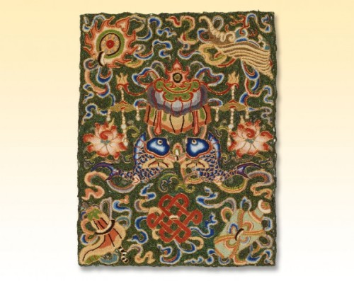 "Fragment of a hanging or cover China, mid 19th century Silk, peacock feathers, metallic wrapped yarn; embroidered The Textile Museum 51.30 Acquired by George Hewitt Myers in 1940 Photo by Renée Comet  A uniquely Chinese solution to the quest for green textiles was the  incorporation of peacock feathers. A master embroiderer created the  iridescent green background on this fabric with silk threads wrapped in  peacock feather filaments. Laborious and costly, peacock feather  embroidery was reserved for use in the highest social and religious  contexts. This fragment likely formed part of a lavish hanging or cover  for a Buddhist ritual, as its colorful patterning depicts the ""eight  precious things"" of the Buddhist faith: double fish, canopy, endless  knot, lotus, vase, conch, umbrella, and the wheel of law.  (via Green: the Color and the Cause)"