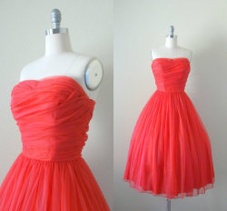 Pretty red vintage strapless dress.  Reminds me a little of what Natalie Portman wore to the oscars.  Click on the picture to go to the shop!