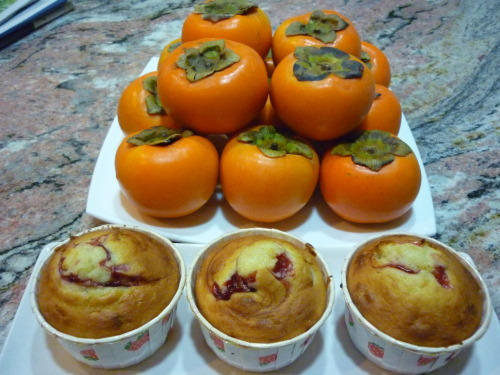 Strawberry Muffins There are no persimmons in the muffins but these fruits are so fresh and vibrant in color that I thought they make good backdrop.   Recipe for Strawberry Muffins                           120 g unsalted butter  120 g sugar  100 g egg  140 g cake/plain flour  4 g baking powder Some salt  Strawberry puree/pie filling 1.      Beat butter and sugar till light and fluffy  2.      Add egg in 5 additions and cream to combine  3.      Sift in flour, baking powder.  Add salt.  Fold to combine  4.      Blend in strawberry puree/filling   5.      Scoop batter into paper cups till ¾ full  6.      Bake at 200 degrees for 20 min  Remarks:  Texture is soft