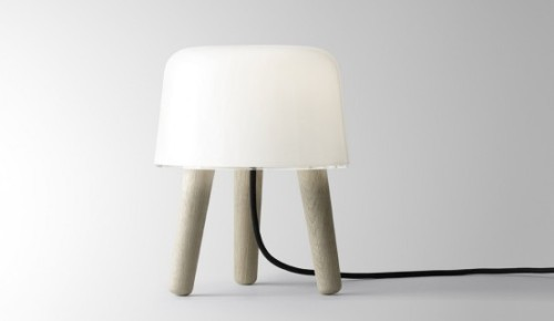 The Milk Lamp is inspired by the classic nordic milk stool and Nordic tradition of wood and glass. It is designed by NORM architects Kasper Rønn & Jonas Bjerre-Poulsen for &tradition. It's the first item in a series of sensory design for the home that comes in two flavors – with black or with white cord. The lamp itself is made in white translucent glass, acrylic and oak. It is dimensioned to fit in all corners of the home for a perfect cosy atmosphere. The angle of the legs, the soft edges and the cord in the middle gives the lamp its anthropomorphic character. It is the perfect decoration for any swedish apartment or any other modern interior design. { NORM architects | &tradition }Read more: http://www.digsdigs.com/cosy-lamp-made-of-white-translucent-glass-and-oak-milk-lamp-by-norm-architects/#ixzz1o9THRg3O