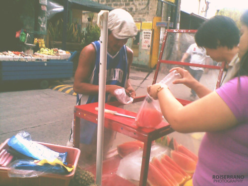 10 QUESTIONS FOR A FRUIT VENDOR The streets of the Philippines is considered to be a place for vendors to sell goods and commodities. It remained a common sight to Filipinos to see street vendors day and night.We have food vendors, people who sell clothes, cellphone accesories, etc. Among all the vendors that I see everyday, Kuya Caloy, a fruit vendor, caught my attention.QUESTION 1: Ano po ang mga kadalasan ninyong ibinibenta na prutas? (What kinds of fruit do you often sell?)KUYA CALOY: Saging, mansanas, mangga. Pero, depende kasi kung ano ang uso. Hindi naman kasi lahat ng prutas ay saganang tumutubo kahit anong oras sa isang taon. May mga buwan lamang na sagana silang tumutubo. Katulad kapag summer, sagana ang mangga, kaya, halos lahat ng nagtitinda ng prutas, mayroong mangga.(Bananas, apples and mangoes but it depends on what other vendors sell. Not all fruits grow at any time in the year. Some fruits only grow abundantly at a specific time of the year. During summer, mangoes grow abundantly.)QUESTION 2: Bakit po kayo dito sa daan nagbebenta ng prutas? Bakit hindi po sa palengke? (Why are you selling fruits on the street? Why don't you sell these at the market instead?)KUYA CALOY: Sa umaga, nasa palengke ako. Tuwing hapon lamang ako nandito sa labas. (During the morning, I sell fruits at the wet market. During the afternoon, I sell fruits on the street.)QUESTION 3: Hindi po ba mahirap magtulak ng kariton na may maraming prutas?(Isn't it difficult to push a cart with many fruits?)KUYA CALOY: Hindi naman mahirap ito, hijo. Sanayan lang siguro. Kapag baguhan ka pa lang kasi, medyo mabibigatan ka at mahihirapan kang magtulak. (It is not difficult. You get used to it. If you're new at this, it would be difficult for you to push a heavy cart.)QUESTION 4: Mga nakakamagkano po kayo bawat araw? (How much do you earn in a day?)KUYA CALOY: Ah, depende sa araw. Pero kadalasan, isang libo tapos may mga dalawang daan na sobra. Kapag linggo, malakas ang benta nitong prutas lalo na sa labas ng simbahan. (It depends on what day of the week. But I often earn one thousand and two hundred pesos. During Sundays, fruits sell a lot especially outside the church.)QUESTION 5: May pamilya po ba kayo? (Do you have a family?)KUYA CALOY: May asawa't isang anak ako. (I have a wife and a child.)QUESTION 6: Nag-aaral na po ba ang anak ninyo? (Does your child already go to school?)KUYA CALOY: Oo naman. Grade 4 na siya. (Of course. My child is already in 4th grade.)QUESTION 7: Tungkol po sa edukasyon, sang-ayon po ba kayo sa K+12? (Are you in favor of K+12?)KUYA CALOY: Oo. Hindi naman kasi iyon dagdag gastos sa pagpapaaral ng mga anak. Buti nga na napagpasya ng gobyerno na magkaroon ng pagpapatupad nito. Hindi lang para sa mga ikabubuti ng ating bansa pero, para sa ikabubuti ng mga Pilipino. (Yes. K+12 is not something that will increase expenditures. Good thing that the government had intentions of implenting this. This is not something that only our country will benefit from. This is something that we, Filipinos, will befenit from as well.)QUESTION 8: Ano po ang gusto ng anak niyo maging? (What is your child's ambition?)KUYA CALOY: Gusto niya maging enhinyero. Gusto daw niya gumawa ng mga building. (He wants to become an engineer. He wants to build.)QUESTION 9: Kung bibigyan po kayo ng pagkakataon na makapagaral ulit, mag-aaral po ba kayo? (Given the chance to study, will you go to school?)KUYA CALOY: Oo naman. Hindi kasi ako nakapagtapos ng kolehiyo. Kahit matanda na ako, iba pa din kasi ang nakapagtapos ka ng pag-aaral. (Of course. I wasn't able to finish college. Even though I'm already old, I want to finish school.)QUESTION 10: Ano po ung kurso ninyo dati na hindi niyo natapos? (What was your program in college that you weren't able to finish?)KUYA CALOY: Architecture. (Architecture)Kuya Caloy is someone who you can learn a lot from. He is different from Filipinos who believe that the K+12 program of the Department of Education is just another avenue to increase expenses. To him, education is not just something to finish, it is a gift. And being able to finish it is an achievement.