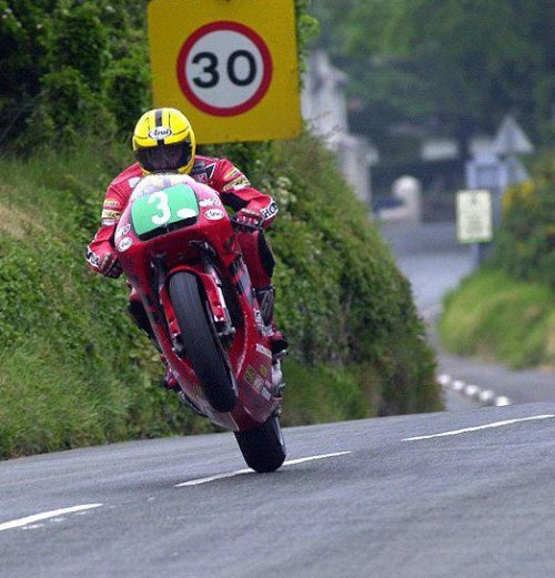 hakkalocken:  Joey Dunlop flies the front wheel through Rhen Cullen on the way to winning the 2000 lightweight TT.