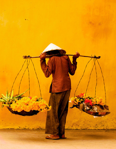 A Vietnamese woman selling flowers on the streets of Hoi An