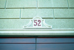 """52"" address number, Milano, Italy Taken with a Canon AE-1, 400 ISO film"