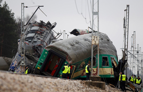 Szczechociny, Poland: emergency services work at  the site of a train crash. At least 15 people were killed when two  passenger trains collided head-on | Peter Andrews/Reuters