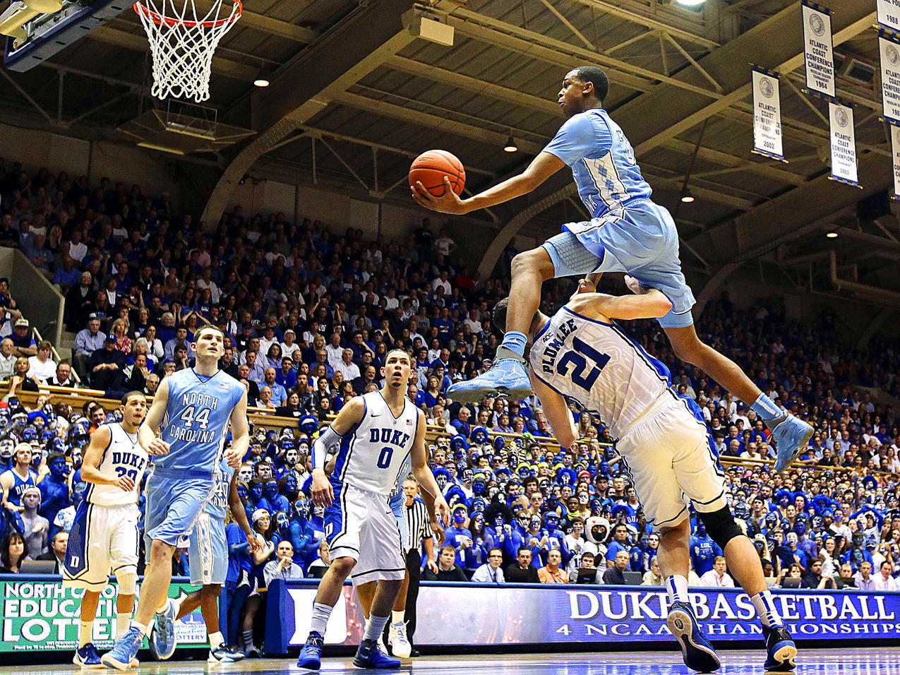 North Carolina's John Henson jumps over Duke's Miles Plumlee during Saturday's game. The Tar Heels dominated from start to finish, defeating the Blue Devils 88-70. (AP) DAUSTER: Tar Heels send message to Duke with impressive victory