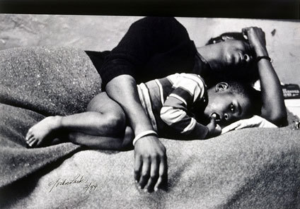 "bessie and her son richard by Gordon Parks Gordon Parks's compelling photograph of Bessie Fontenelle and her youngest son Richard, Jr., was published by Life magazine on March 8, 1968, as part of a special feature on blacks and poverty called A Harlem Family (or At the Poverty Board). Parks's essay and twenty-five photographs vividly depict the hardships of a Harlem family living under deplorable conditions. Taken shortly after Bessie violently retaliated against her husband's abuse, this image, which appears on the opening spread, captures both her love for her son and her deep frustration and exhaustion—the dichotomy of a life torn between hope and despair. Her sadness is tempered by her child's wide-eyed innocence. The article begins with this admonition: ""What I want/What I am/What you force me to be/is what you are,"" suggesting that we are all part of one global family. Sadly, only young Richard survived the family's hardships and grew up to escape poverty. by Indiana University Art Museum"