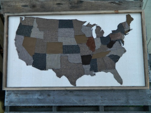 "USA map created from various tweed materials from old blazers, sports coats, skirts, and pants. Each state has been cut out by hand. The background is a canvas drop cloth. Weathered and salvaged 1x(s) give the upcycled art piece a finished look. Size: 47""w x 26""h Wholesale price: $125 Retail price: $225"