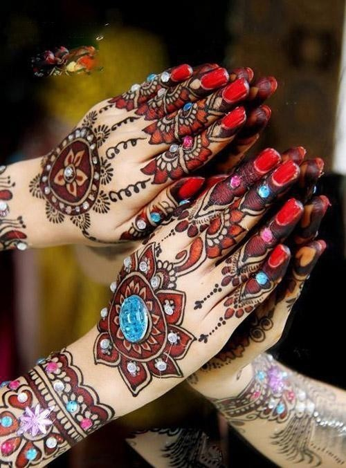 Mehndi (HENNA)  is the application of henna as a temporary form of decoration skin in India.