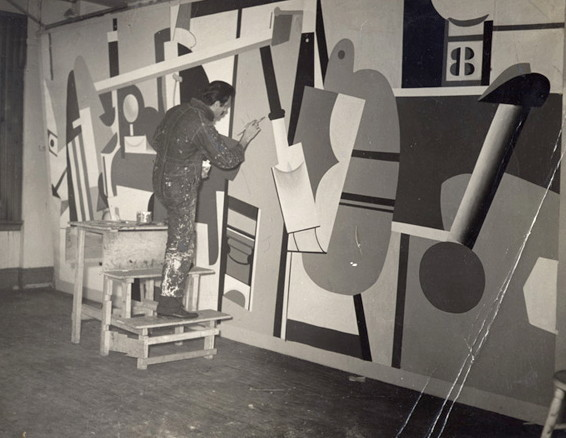 Arshile Gorky at work on Activities on the Field, his mural project for the Newark Airport, 1936.  New York Federal Art Project photo.