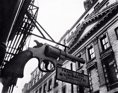 Frank Lava Gunsmith - 240 Centre Street, New York, NY. [Photo taken on February 4, 1937] Frank Lava's Gun Shop was founded in 1850 by Eli Parker. It was shuttered during the Civil War, but was re-opened and back in business by 1870. The Lava Gunsmiths would do repair and weapons service for the New York Police Department, until the department finally retained their own, in-house, armorers, which ultimately led to the demise and closure of the shop.