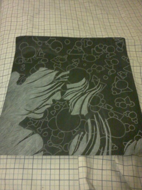 White colored pencil and black paper.