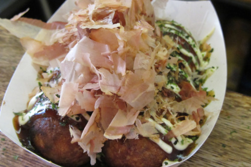 Takoyaki has gone viral. From the streets of Osaka to New York City's East Village, this Japanese junk food fills its own foodie niche. Warm, pancake batter-like balls filled with savory octopus are cooked in a special iron pan. The takoyaki are drizzled with sweet takoyaki sauce and mayonnaise then topped with green aonori and shaved bonito flakes. Takoyaki from Otafuku 236 East 9th St., New York NY