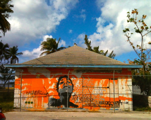 Bahamian Street Art . When traveling, I make sure to look for the street art because it's a great way to learn about the culture. It's all about context. I mean, you wouldn't see this in NY and the subject matter wouldn't usually have palm tree outlines, an island print, and a different language tagged on a wall. The colors are used differently too; a bright orange wall contrasting a Caribbean blue sky. If you walk around the local neighborhoods, you'll notice their bright choice of color on Westernized architecture. Some buildings are neon coral with dark brown window shutters. You don't see that everyday.  Travel.  'Cable Beach' in the Bahamas