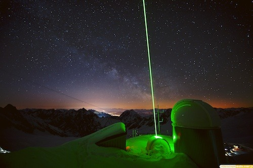 LIDAR & The Milky Way above Innsbruck  by Christoph Malin  The LIDAR (DIAL) Laser System of the Karlsruhe Institute of Technology at the Schneefernerhaus Research Station below the Zugspitze Peak.