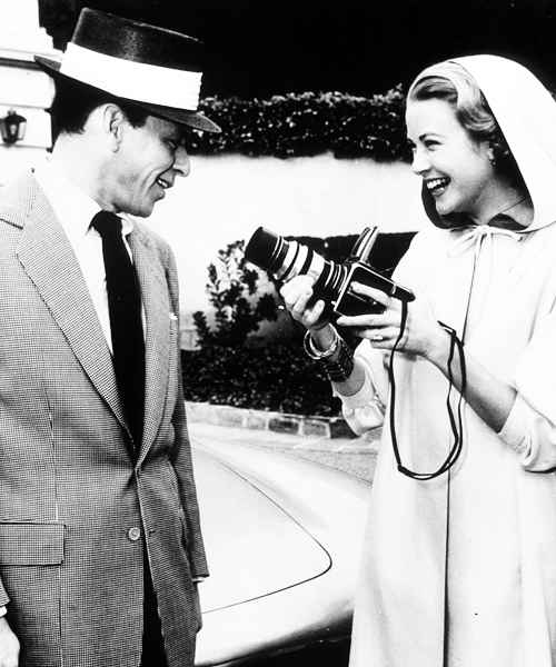 Grace Kelly taking Frank Sinatra's photo with a Hasselblad.