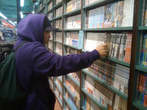 Photography Of Dres Mera-Ya boy browsing at manga @ Kinokuniya Bookstore in Chinatown/ID