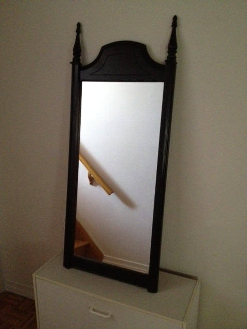 Wooden mirror painted in black gloss. Has a great gothic, fairy tale feel to it. We think it'll fit with the Alice in Wonderland meets backstage dressing room vibe we want in our eventual boutique.