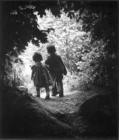 A Walk To The Paradise Garden   W. Eugene Smith  He was one of the great war photographers but had  suffered injuries that in 1946 had taken two years to hopefully heal.  He was not sure if his career was over.  One day he went for a walk with his children… I knew the photograph, though not perfect, and however unimportant to the world, had been held…. I was aware that mentally, spiritually, even physically, I had taken a first good stride away from those past two wasted and stifled years.  While he was right about his stride towards recovery, Smith miscalculated the photo's importance. In 1955, a heavily-indebted Smith decided to submit the photo to Edward Steichen's now-famous Family of Man exhibit at the MOMA. There, it became a finalist and then the closing image, thus cementing its position as the icon of all family photographs.