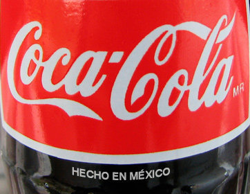 Crazy for Mexican Coke Not all Cokes are created equal. And many Americans are now saying that in Mexico they do it better. Mexican Coca-Cola, once a piece of nostalgia for Hispanic immigrants, is increasing its presence in the US market.  Most people, though, say it's about the sugar. Mexican Coca-Cola is sweetened with cane sugar as opposed to the high-fructose corn syrup (HFCS) used in the American version. Coke switched to HFCS in the 80's when the US government started subsidizing corn growers making it much cheaper than sugar.   Taste isn't the only thing going for the Mexican Coke. While it's not yet clear that high-fructose corn syrup is any worse than cane sugar, it's quickly becoming one of the most dreaded ingredients in the American diet. Present in most soft drinks, it's been blamed for the rise in obesity and diabetes rates in the country. Still can't find a Mexican Coke? Try www.wheretofindmexicancoke.com. [univisionnews.tumblr.com]  ——— The more natural it is, the tastier it become.