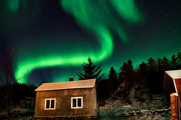 "Pretty. Images of aurora borealis more intense this year due to ""cracks in the earth's magnetic shield."" From National Geographic."