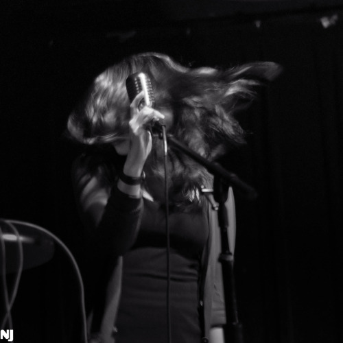 Lisa, our singer, ruling at Black Cat during our record release show. by Nathan Jurgenson