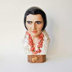 The King Elvis Bust,Everyone could use a little bit of the King in his or her home. This circa 1978 bust is a U-paint ceramic piece. Rhinestones, fine details in the flowers and eyelashes, and a little guitar on the base make this bust one for the mantle.