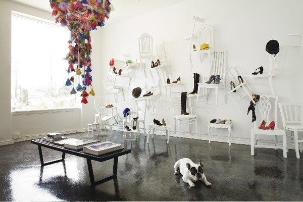 What an amazing display idea! Boutique Ten Over Six in L.A. With the amount of vintage wooden chairs we've accumulated this would be very doable. We're honestly starting to feel like hoarders.  ~lili