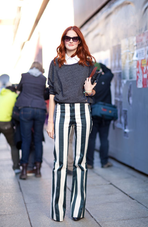 what-do-i-wear:  Taylor Tomasi-Hill in striking vertical stripes during  Milan Fashion Week (image: harpersbazaar)