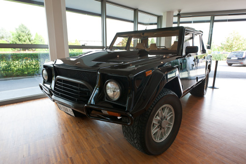 Lamborghini LM002. With all the popularity of Range Rovers and G-Wagons and the like it's easy to forget where the pumped up SUV look began. Back in 1986, when bare G-Wagons were still primarily used for hit and run espionage missions into East Germany, Lamborghini took the off-roader and turned it into a monster by evolving the mid-engined Cheetah into the front-engined LM002. Powered by a detuned 444bhp version of the 5.2 litre V12 from the Countach and weighing well over 2 and a half tons the LM002 was faster than a Golf GTI of the day, yet could climb a 120% gradient unassisted. The enormous Scorpion tyres were specially developed by Pirelli. 301 were built with most going to the deserts of the middle east. Lamborghini Museum, Sant'Agata Bolognese, Italy.