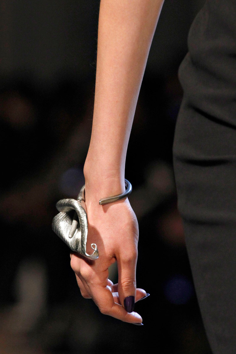 darklamb:  Calla lily wristlet at Yves St Laurent Fall 2012. Pilati's finale. (Image via Vogue.com)