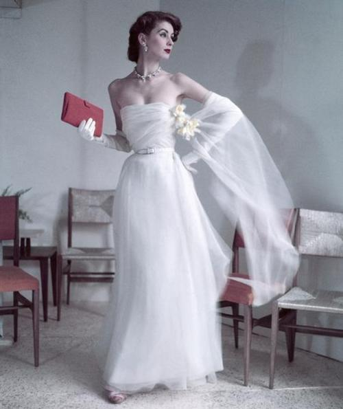 theniftyfifties: Suzy Parker wearing a white evening gown, 1950s.