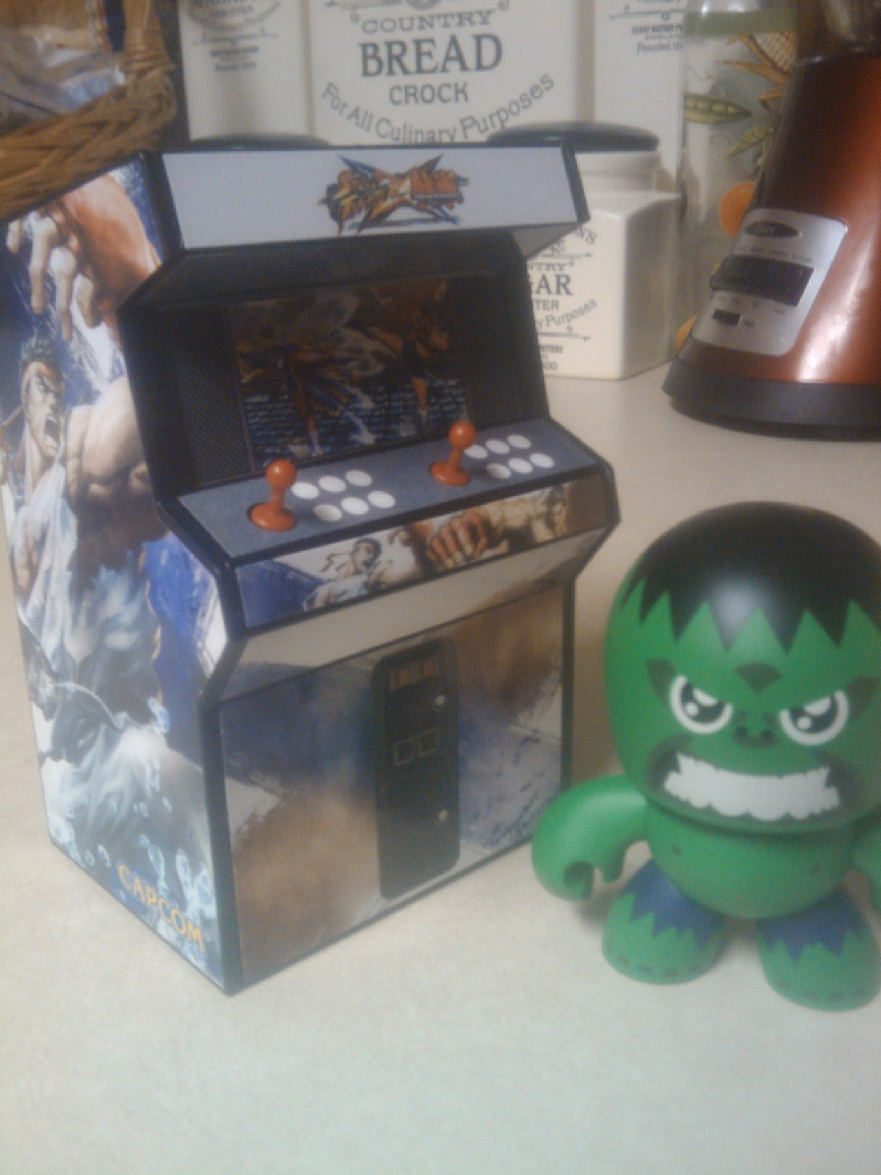 dude the arcade cabinet piggy bank model kit the special edition of SFxT came with is ADORABLE hahah just got done making mines :3