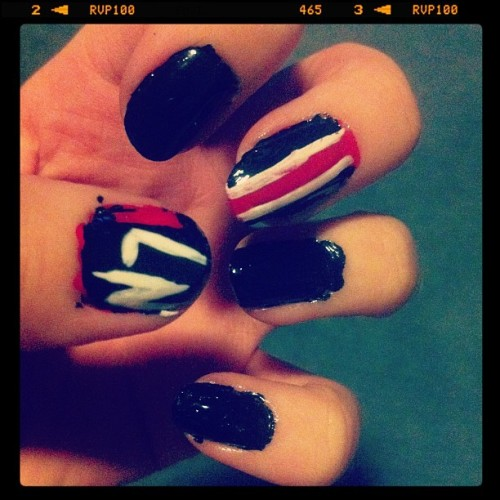 My quite messy & rather awkward Mass Effect N7 nail art. (Taken with instagram)
