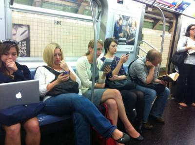 New York subway - macbook, iphone, kindle, ipod, book - via Reddit