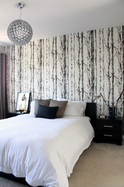 I've been obsessed with birch tree wallpaper ever since I saw this bedroom photo on houzz.com. I'm currently working on a project that features a similar wall treatment—photos to come! The trees add a perfect touch of whimsy without being too kitsch. I feel like this room contains so much of what I love: A black and white color palette, a touch of modern and a touch of whimsy. And what's better than diving into clean, crisp, all-white bedding on an oversized bed? ~lili
